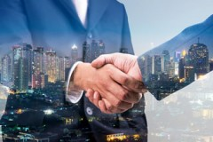 consummating a business transaction with a handshake