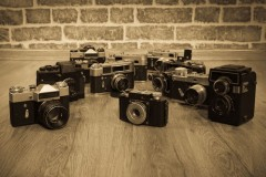 antique cameras on a wooden floor