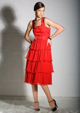 young woman wearing a red party dress